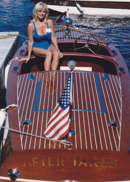 Rosemary Sexton sits on boat